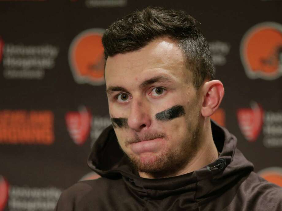 Cleveland Browns quarterback Johnny Manziel speaks with media members following the team's 30-13 loss to the Seattle Seahawks n an NFL football game, Sunday, Dec. 20, 2015, in Seattle.  (AP Photo/Scott Eklund) Photo: Scott Eklund, FRE / FR171040 AP