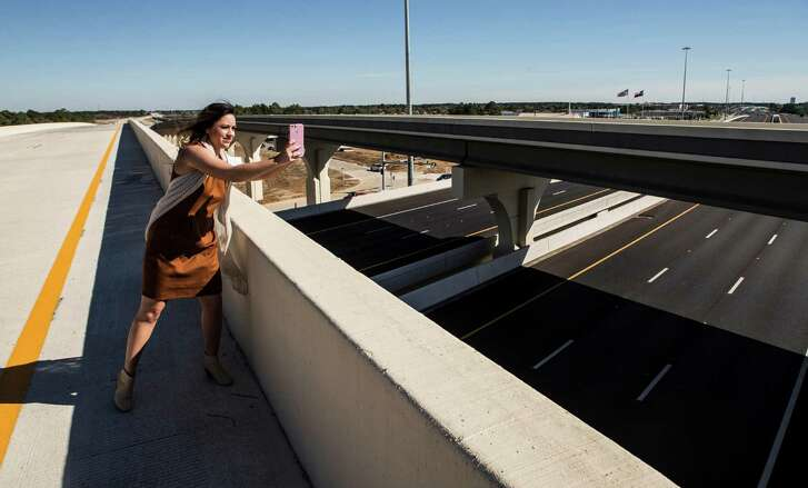 Angela Storseth takes in a quiet Grand Parkway before the 24-mile section opened to traffic, connecting Cypress, Tomball and The Woodlands between U.S. 290 and Interstate 45.