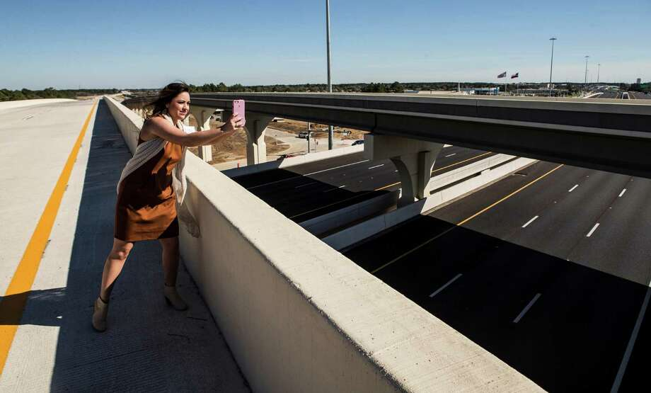 Angela Storseth takes in a quiet Grand Parkway before the 24-mile section opened to traffic, connecting Cypress, Tomball and The Woodlands between U.S. 290 and Interstate 45. Photo: Brett Coomer, Staff / © 2016 Houston Chronicle