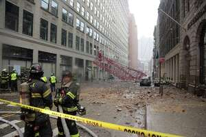 One dead as crane topples - Photo