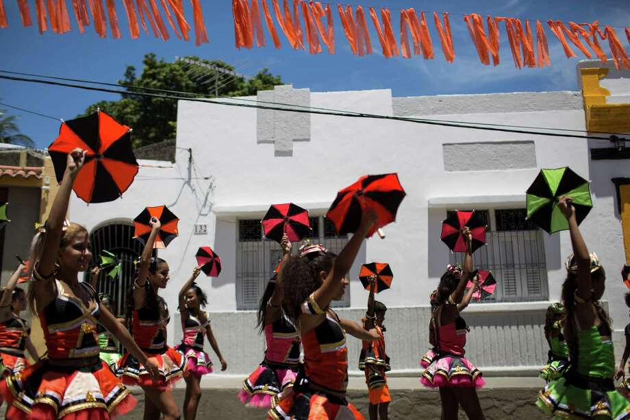 "Young revelers dance frevo during the ""Burial of the Mosquito"" carnival block parade in Olinda, Pernambuco state, Brazil, Friday, Feb. 5, 2016. The parade that happens every year during carnival inform residents and tourists about the dangers of the Aedes aegypti and teaches them how to combat the mosquitoes. (AP Photo/Felipe Dana) ORG XMIT: XFD106 Photo: Felipe Dana / AP"