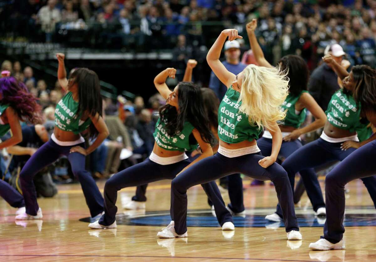 The Dallas Mavericks dancers perform during the first half of an NBA basketball game against the San Antonio Spurs on Friday, Feb. 5, 2016, in Dallas. (AP Photo/Jim Cowsert)