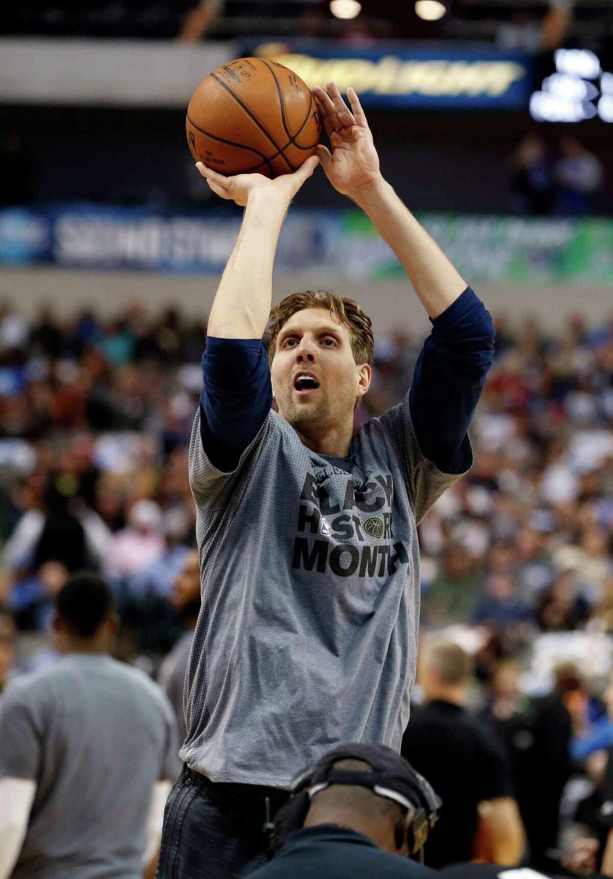 Dallas Mavericks forward Dirk Nowitzki warms up before the first half of an NBA basketball game against the San Antonio Spurs on Friday, Feb. 5, 2016, in Dallas. (AP Photo/Jim Cowsert)