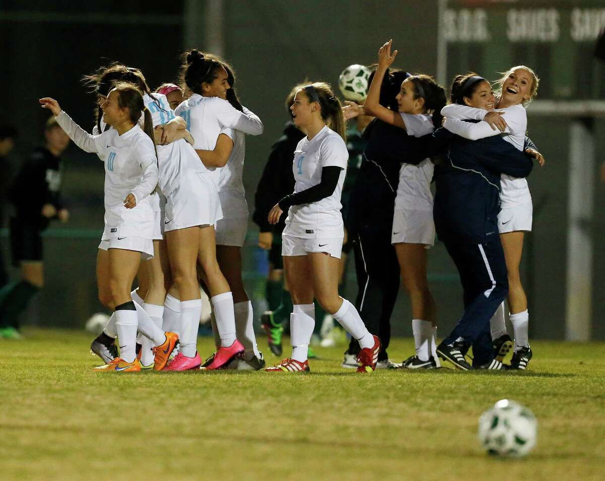 The Johnson varsity girls soccer team celebrates after defeating Reagan at Blossom Soccer Stadium on Friday, Feb. 5, 2016. Johnson rallied from an early Reagan score to then taking control in the second half to defeat Reagan, 2-1. (Kin Man Hui/San Antonio Express-News)
