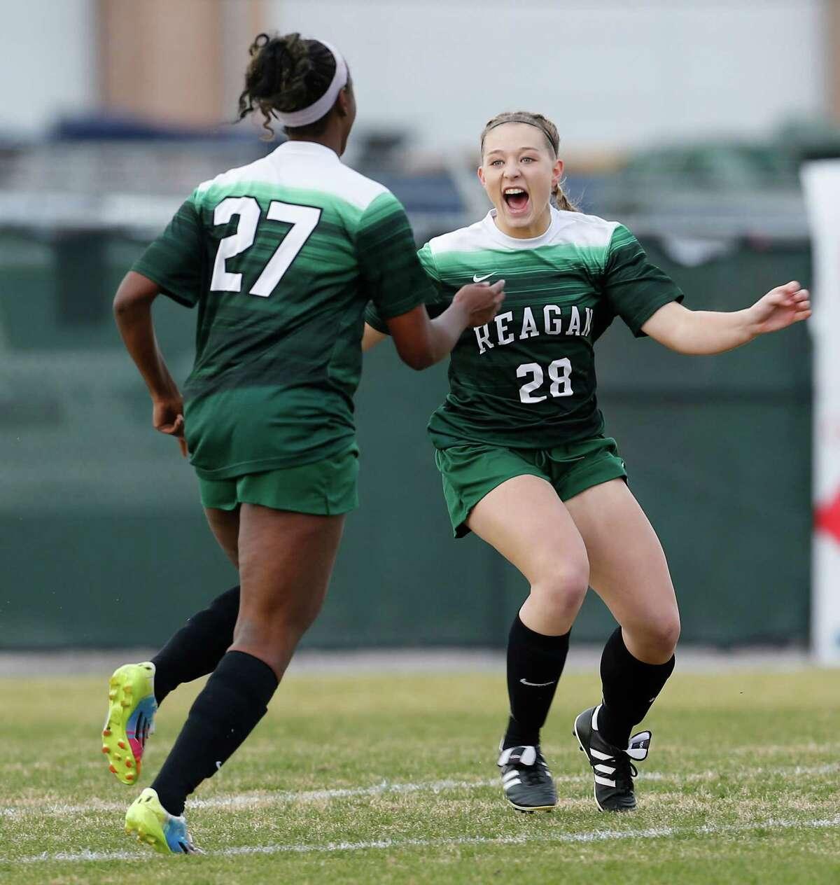 Reagan's Taylor Olson (28) reacts after scoring an early goal against Johnson in girls soccer at Blossom Soccer Stadium on Friday, Feb. 5, 2016. Johnson defeated Reagan, 2-1. (Kin Man Hui/San Antonio Express-News)