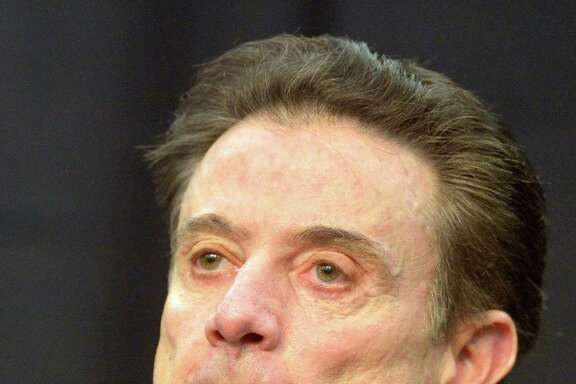 """Louisville coach Rick Pitino said the one-year postseason ban the school imposed on the men's basketball program Friday """"is as harsh as anything I've ever seen in college basketball."""""""