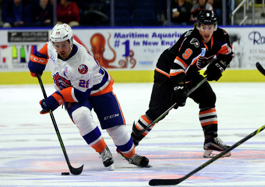 Sound Tigers' Mike Halmo moves the puck as Lehigh Valley's Cole Bardreau tracks him during AHL hockey action at the Webster Bank Arena in Bridgeport, Conn. on Friday Feb. 5, 2016. Photo: Christian Abraham / Hearst Connecticut Media / Connecticut Post