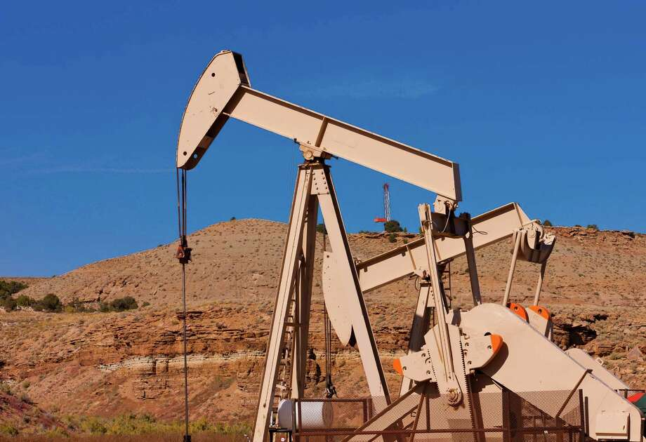 Pumpjacks in Utah's Uinta Basin tap wells of Houston-based Linn Energy, which said on June 30, 2014 that it was acquiring additional assets in the West and other regions from Devon  Energy. Photo: Linn Energy / © 2011 Jim Blecha
