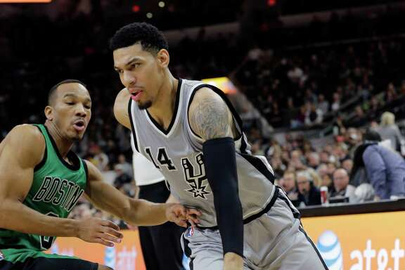 San Antonio Spurs guard Danny Green (14) drives around Boston Celtics guard Avery Bradley (0) during the first half of an NBA basketball game, Saturday, Dec. 5, 2015, in San Antonio. (AP Photo/Eric Gay)