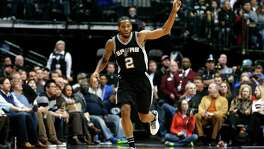 San Antonio Spurs forward Kawhi Leonard (2) celebrates sinking a basket against the Dallas Mavericks during the first half of an NBA basketball game, Friday, Feb. 5, 2016, in Dallas. (AP Photo/Jim Cowsert)