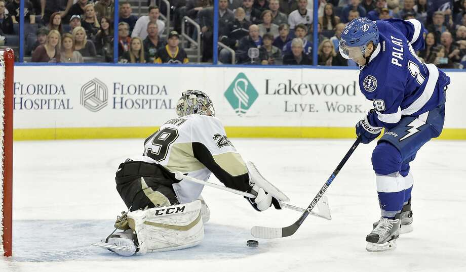 Tampa Bay's Ondrej Palat slips the puck past Pittsburgh goalie Marc-Andre Fleury for a short-handed goal that gave the Lightning a X-X lead in the second period. Photo: Chris O'Meara, Associated Press