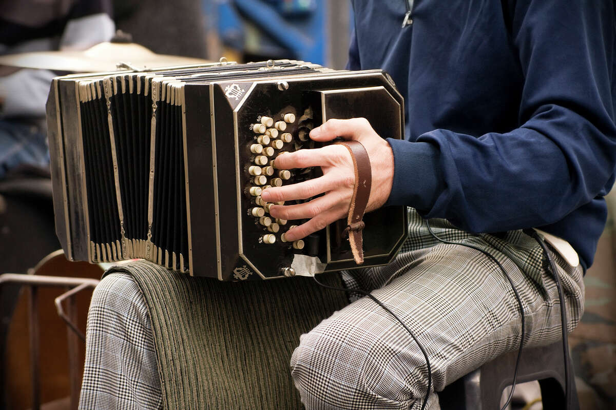 A man playing the bandoneon, similar to the instrument featured in the Feb. 5, 2016 festival program.