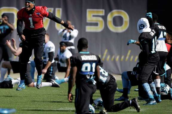 Panthers quarterback Cam Newton, left, has a good time during Friday's practice. He also was in fine form, tossing just one incompletion.