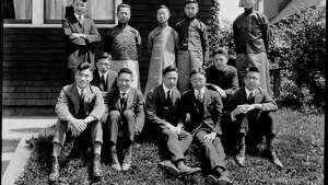"""In 1920 and 1921, China suffered a serious famine made worse by civil war. Between 15 and 25 million people died in five northern provinces alone. In Seattle, people of Chinese ancestry worked hard to raise money for the Chinese Famine Fund. This photo shows a group of Chinese students from the University of Washington who acted as tour guides in Chinatown to raise money for famine relief. Some of the students wear traditional clothing and others wear western clothing."" -MOHAI. Photo courtesy MOHAI, PEMCO Webster and Stevens Collection, image number 1983.10.2190."