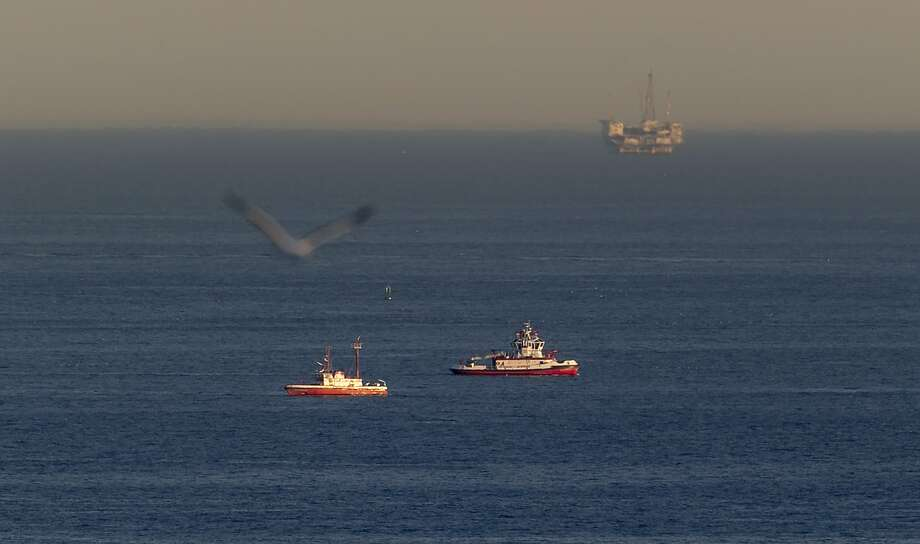 Rescue boats search for wreckage from two small planes that collided in midair off of Los Angeles. Photo: Damian Dovarganes, Associated Press