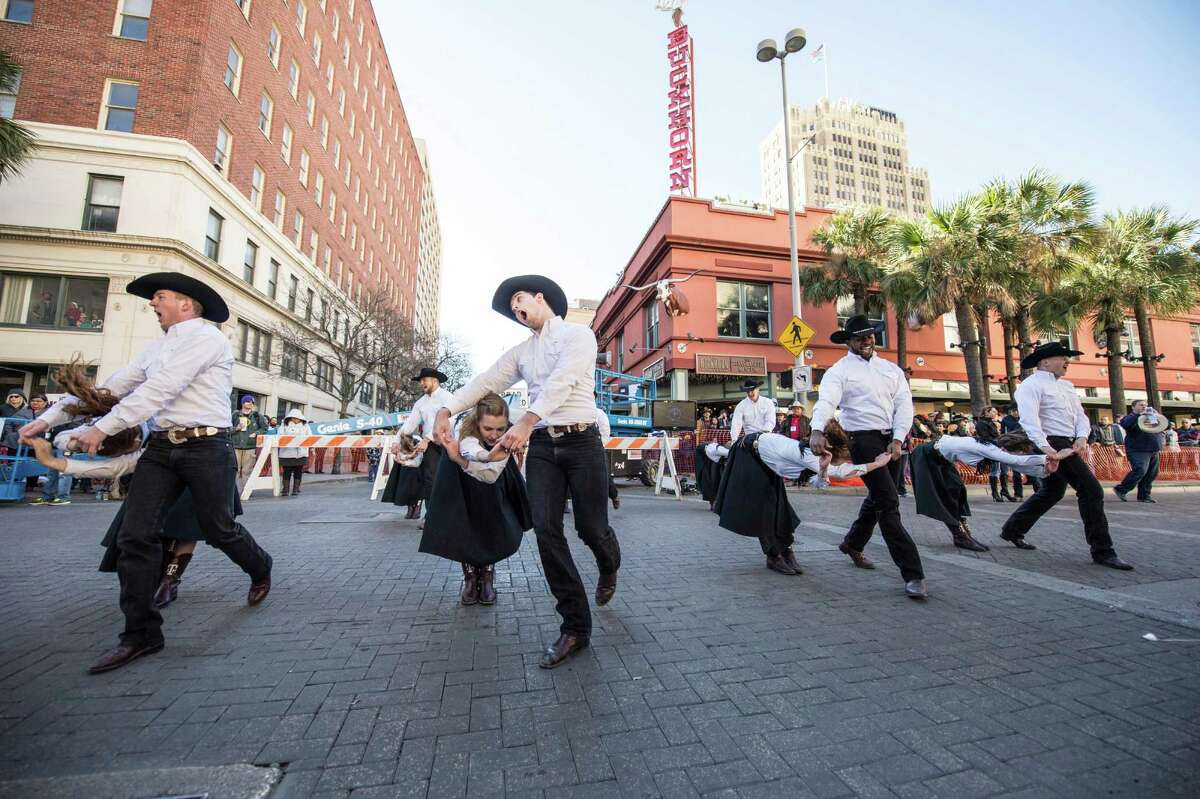 Aggie Wranglers dance before the Western Heritage Parade and Cattle Drive in downtown San Antonio on Saturday, Feb. 6, 2016.