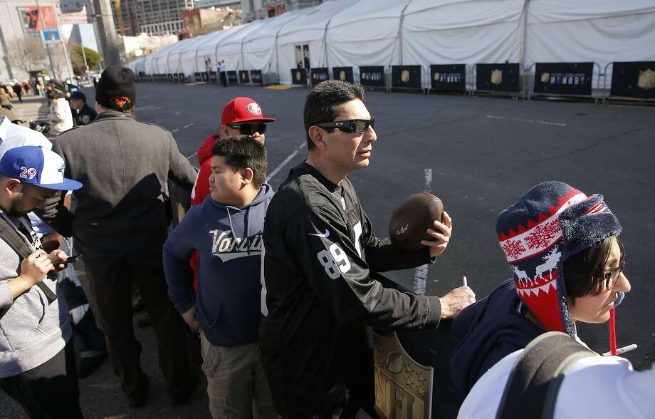 Raider Los of Santa Cruz waits for autographs outside the NFL Honors event in the Bill Graham Civic Auditorium across from City Hall, in San Francisco, Calif., on Sat. February 6, 2016. Photo: Michael Macor, The Chronicle