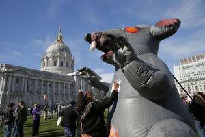Partyers and protesters mark last full day of Super Bowl City - Photo