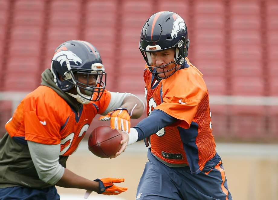 Peyton Manning will have to be a game manager, which includes handing off to C.J. Anderson. Photo: Ezra Shaw, Getty Images