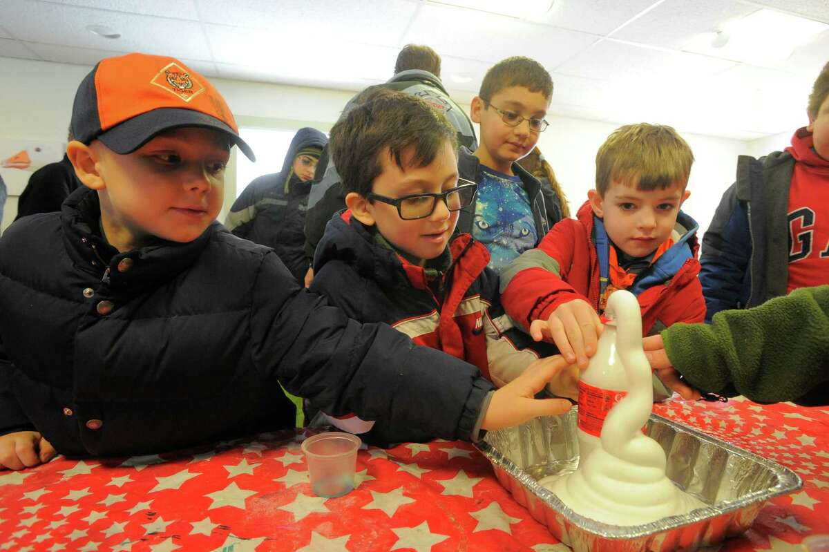 From left, Cub Scouts Patrick Collin, Aidan Spohn, Jim Deacy and Peter Demasip, all from Norwalk Pack 66 learn about chemical reactions in the Reactions Lab during the Cub Scout Winter Wild at the Stamford Museum and Nature Center in Stamford, Conn. on Feb. 5, 2016. Over 400 Cub Scouts and their families participated in the event that explored rainforest animals, beetles and bone artifacts, owl artifacts, making elephant toothpaste, making paper out of recyclables, fire-starting with a bow drill and a big Star Wars exhibit.