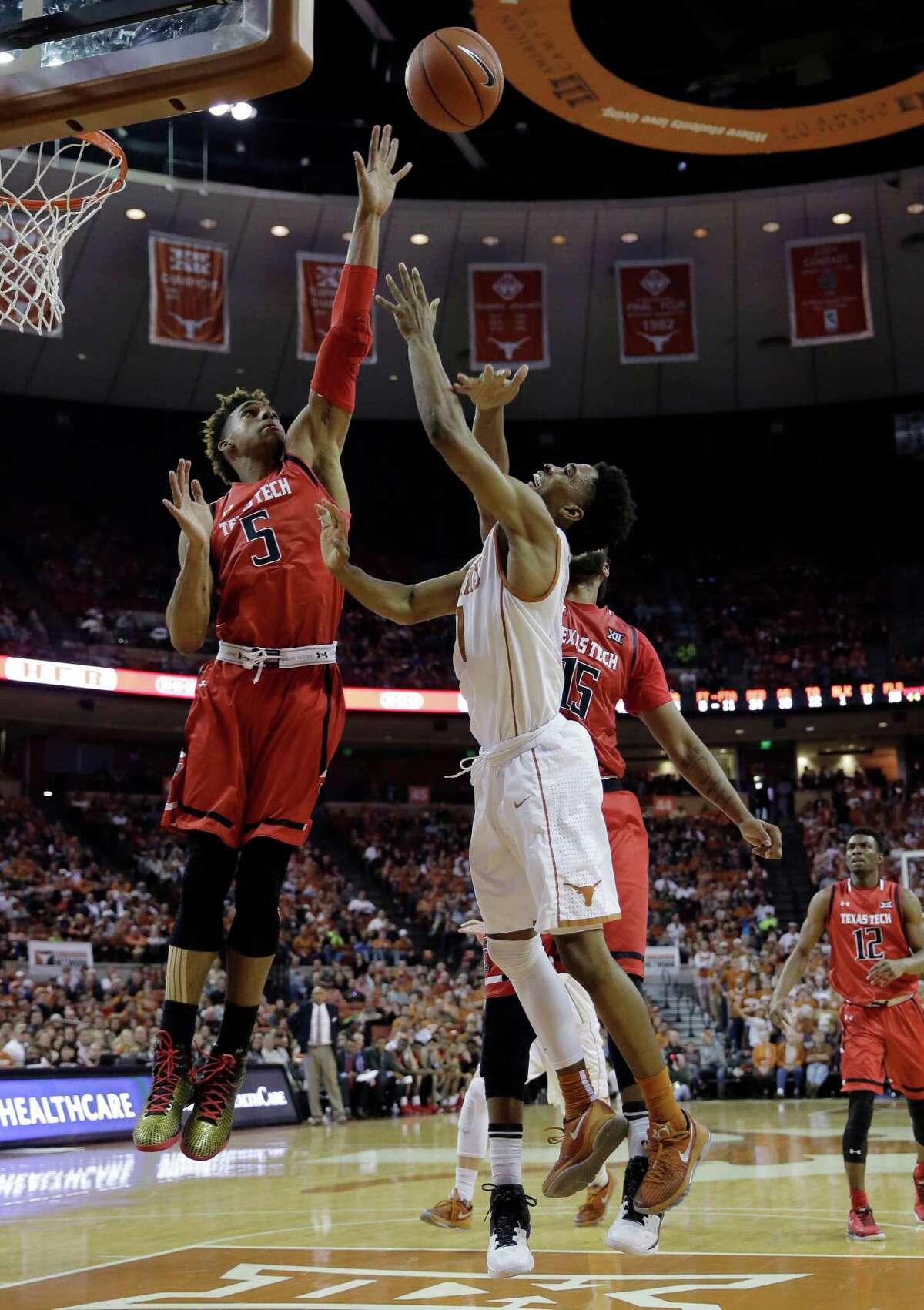 Texas guard Isaiah Taylor (1) shoots over Texas Tech forward Justin Gray (5) during the second half of an NCAA college basketball game, Saturday, Feb. 6, 2016, in Austin, Texas. Texas won 69-59. (AP Photo/Eric Gay)