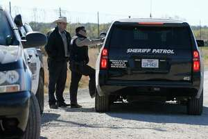 Uvalde County Sheriffs Deputies guard the intersection to a neighborhood several miles outside of Uvalde after a standoff resulted in multiple deaths on Saturday, Feb. 6, 2016. The incident started around 5 p.m. on Friday. Officials have not given an official account about the circumstances surrounding the standoff.