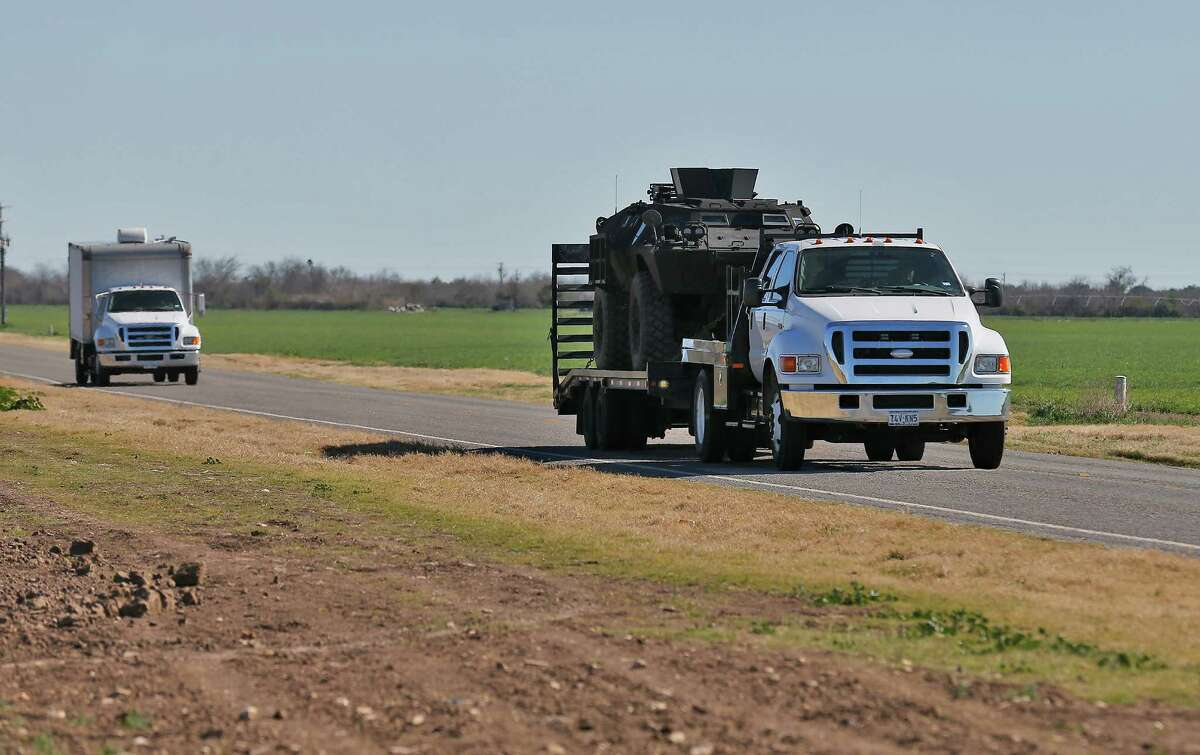 A vehicle that was supposedly used in a standoff near Uvalde passes along Pearsall Road in Uvalde, Texas after the incident resulted in multiple deaths on Saturday, Feb. 6, 2016. The incident started around 5 p.m. on Friday. Officials have not given an official account about the circumstances surrounding the standoff.