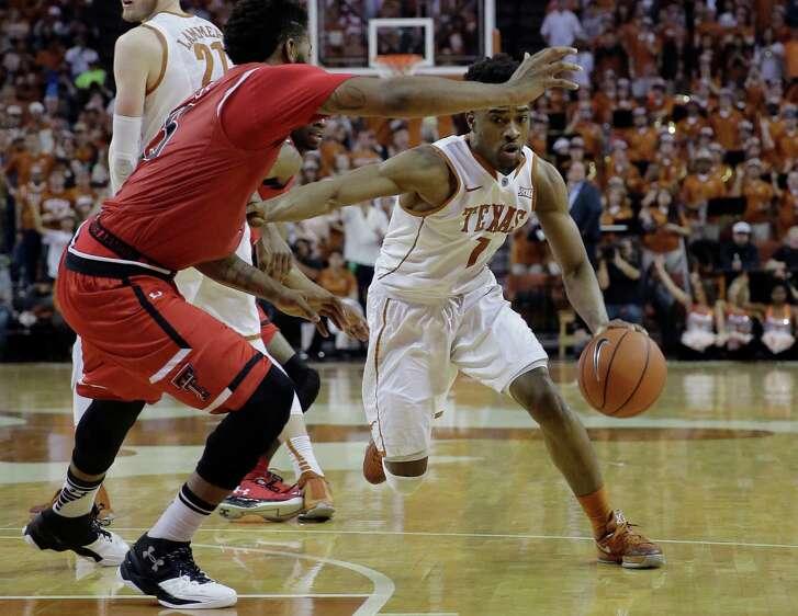 Texas guard Isaiah Taylor (1) drives around Texas Tech forward Aaron Ross (15) during the second half of an NCAA college basketball game, Saturday, Feb. 6, 2016, in Austin, Texas. Texas won 69-59.  (AP Photo/Eric Gay)