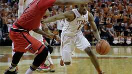 Texas guard Isaiah Taylor (1) drives around Texas Tech forward Aaron Ross (15) during the second half of an NCAA college basketball game, Saturday, Feb. 6, 2016, in Austin, Texas. Texas won 69-59.  (AP Photo/Eric Gay)