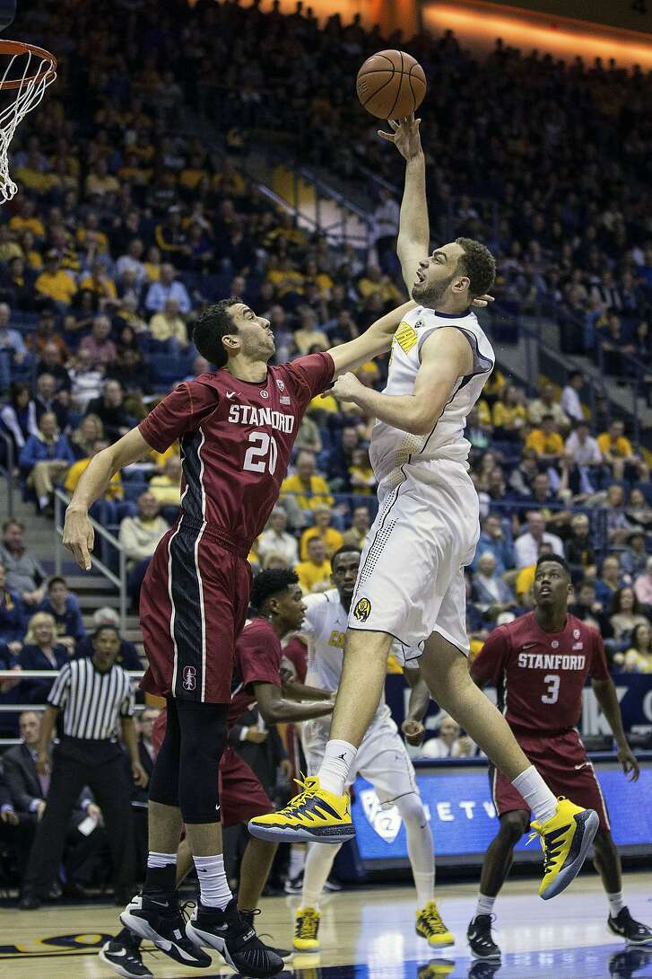 California center Kameron Rooks, right, shoots over Stanford center Josh Sharma (20) during the first half of an NCAA college basketball game in Berkeley, Calif., Saturday, Feb. 6, 2016. (AP Photo/Jason O. Watson)