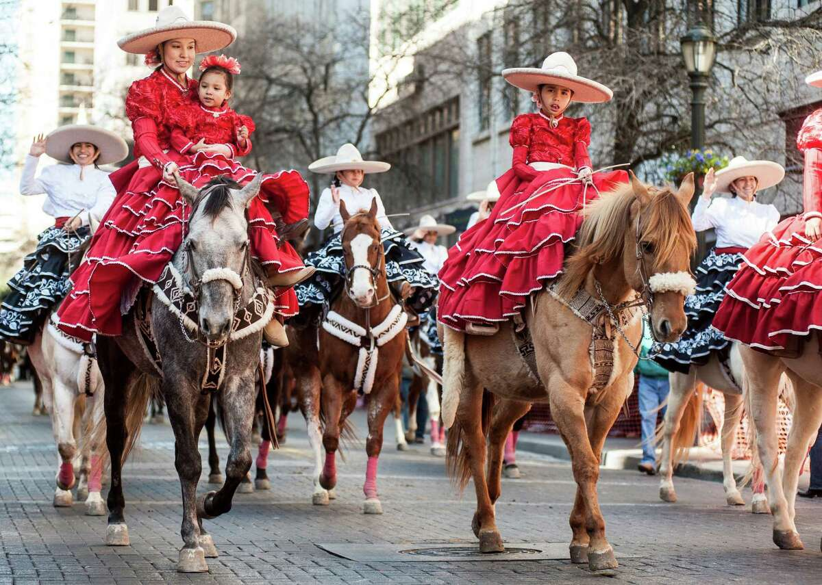 Parade marchers ride Western Heritage Parade and Cattle Drive in downtown San Antonio on Saturday, Feb. 6, 2016.