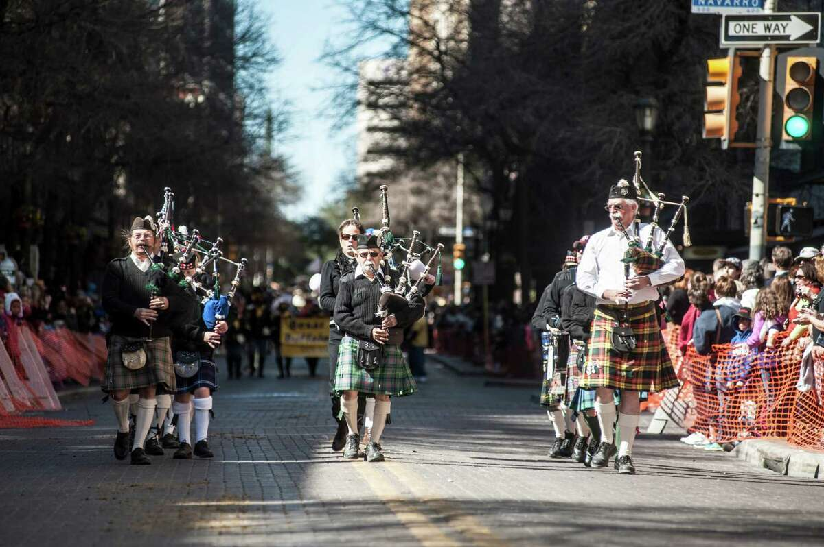 Members of the San Antonio Pipes and Drums march during the Western Heritage Parade and Cattle Drive in downtown San Antonio on Saturday, Feb. 6, 2016.