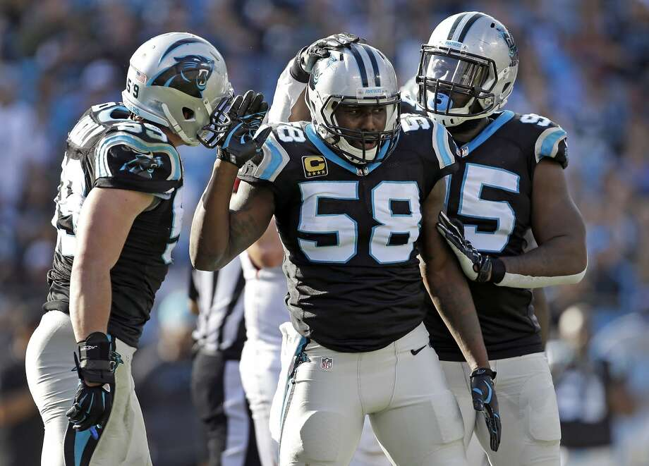 Thomas Davis (58), who has come back from three celebrates after a play against the Atlanta Falcons with Luke Kuechly (59) and Charles Johnson (95) in the first half of an NFL football game in Charlotte, N.C. After overcoming three torn ACLs to the same knee and battling 11 years to get to the Super Bowl, it almost seems cruel that Davis will have to play the biggest game of his life with a broken arm. But the former NFL Walter Payton Man of the Year is used to overcoming adversity. (AP Photo/Bob Leverone, File) Photo: Bob Leverone, Associated Press