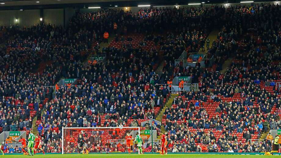 Liverpool fans leave the stands en masse after 77 minutes of play to protest a rise in ticket prices. Photo: Lindsey Parnaby, AFP / Getty Images