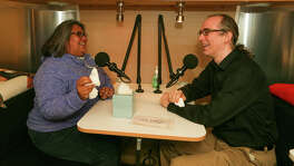 Elisa Gonzales (left) and Nathan Cone, both with Texas Public Radio, sit in the recording studio in the StoryCorps' MobileBooth--an Airstream trailer outfitted with a recording studio--parked at the San Antonio Central Library on Saturday, Feb. 6,, 2016.  Texas Public Radio is hosting a visit to San Antonio by StoryCorps, the renowned national project that celebrates the stories of everyday Americans.  StoryCorps will spend a month recording interviews with San Antonio area residents at the Central Library as part of its cross-country MobileBooth tour.  MARVIN PFEIFFER/ mpfeiffer@express-news.net