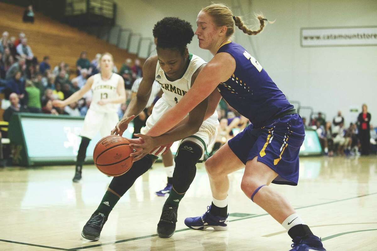 Albany's Haether Forster (22) battles for the ball with Vermont's Kylie Bulter (1) during the women's basketball game between the Albany Great Danes and the Vermont Catamounts at Patrick Gym on Saturday afternoon February 6, 2016 in Burlington. (BRIAN JENKINS/for the FREE PRESS)