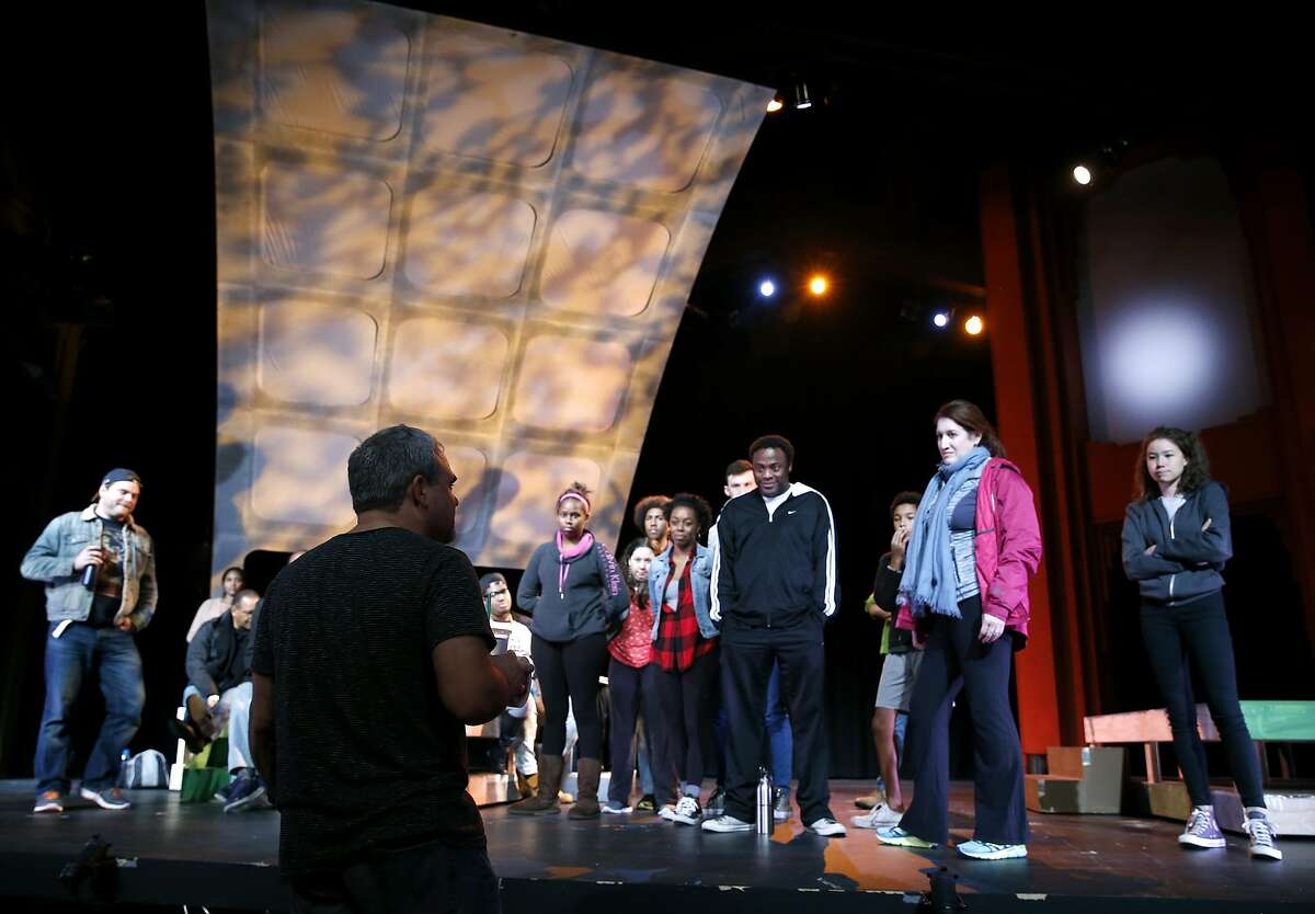 Producing Artistic Director Daren Carollo meets with the cast members of