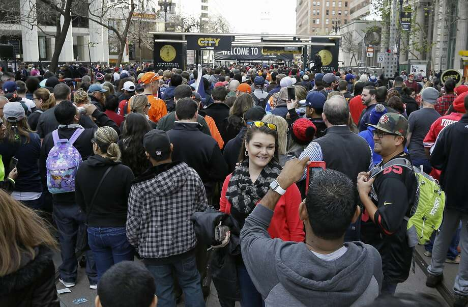 A woman has her picture taken as crowds jam Market Street to enter Super Bowl City Saturday, Feb. 6, 2016, in San Francisco. Long lines of people wrapped around blocks at several entrances to the free-to-the-public fan village designed to celebrate Super Bowl 50. (AP Photo/Eric Risberg) Photo: Eric Risberg, Associated Press
