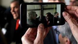 A woman takes video of Republican presidential candidate, New Jersey Gov. Chris Christie at a campaign event, Saturday, Feb. 6, 2016, in Bedford, N.H. (AP Photo/Elise Amendola)