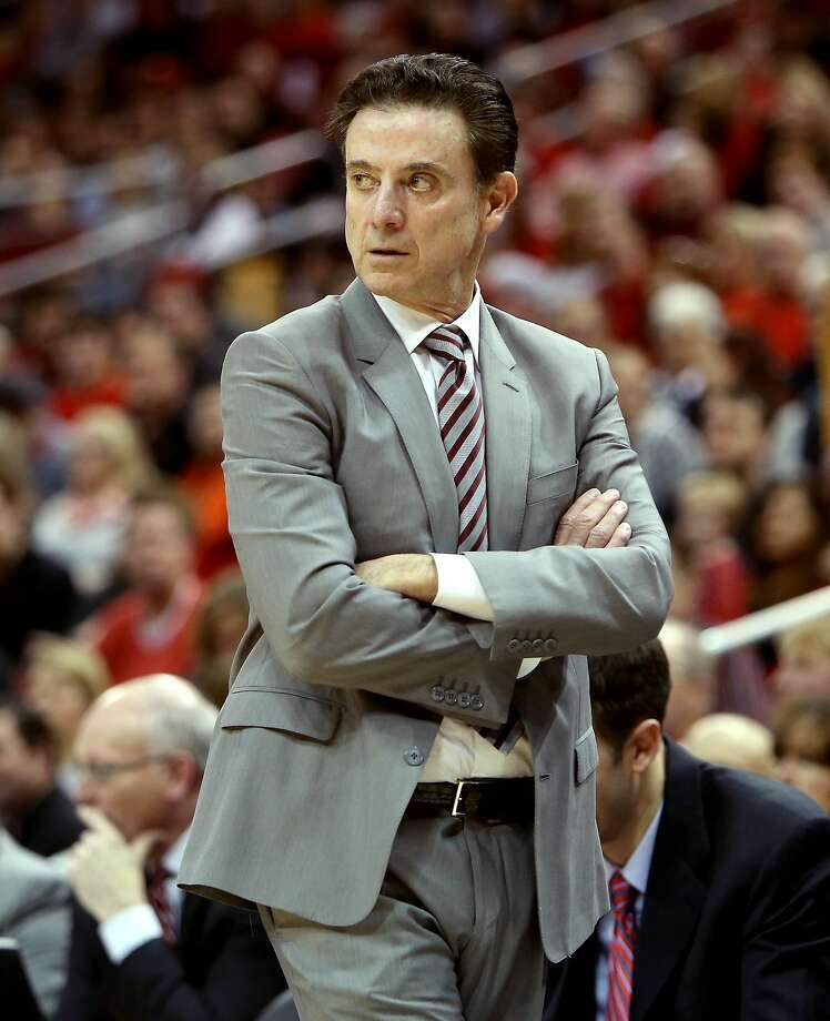 Louisville head coach Rick Pitino stalks the sidelines a day after his team was hit with a postseason ban. Photo: Dylan Buell, Getty Images
