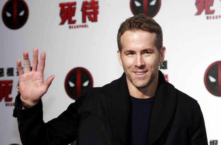 "Canadian actor Ryan Reynolds poses for press before the premier of his new film ""Deadpool"" Thursday, Jan. 21, 2016, in Taipei, Taiwan. The film ""Deadpool"", based on a Marvel Comics character, will open in Taiwan early February. (AP Photo/Chiang Ying-ying) Photo: Chiang Ying-ying, Associated Press"