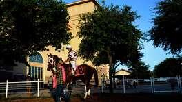 Donald Guynes rides Tnb Rockin Chick at Retama Park in Selma, Texas on July 17, 2015.