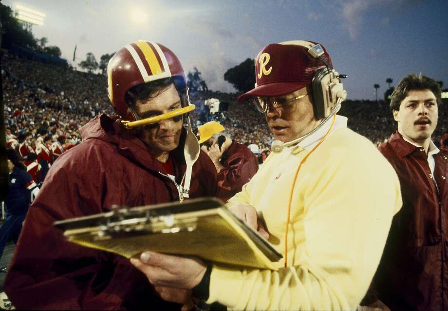 Pro Football Hall of Fame and Washington Redskins head coach Joe Gibbs discussing a play with Wahington quarterback Joe Theismman (7) during the 4th quarter in the Redskins 27-17 victory over the Miami Dolphins in Super Bowl XVII on January 30, 1983 at the Rose Bowl in Pasadena, California. (Photo by Nate Fine/Getty Images) Photo: Nate Fine, NFL