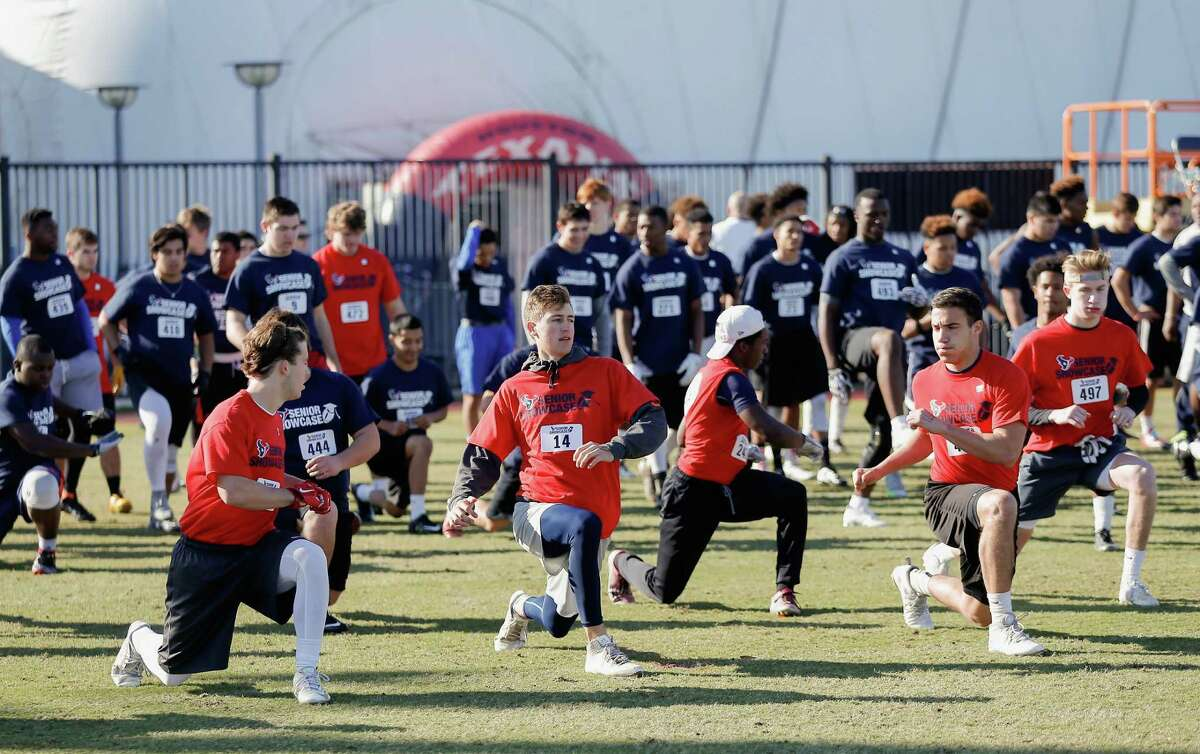 Quarterback Ryan Rake (14) of Obra D. Tomkpins High School stretches with the other senior football players during the Senior Showcase at the Houston Texans Methodist Training Center on Saturday, Feb. 6, 2016.