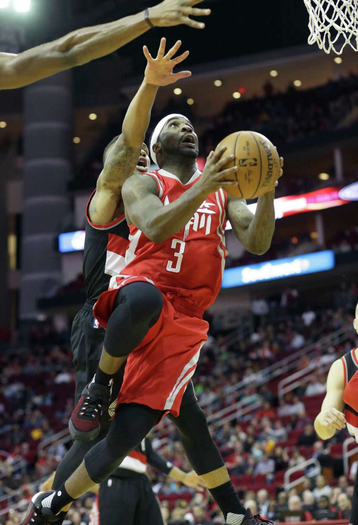 Houston Rockets' Ty Lawson (3) looks to the basket with Portland Trail Blazers' Damian Lillard at his back in the second half of an NBA basketball game Saturday, Feb. 6, 2016, in Houston. Portland won 96-79. (AP Photo/Pat Sullivan)