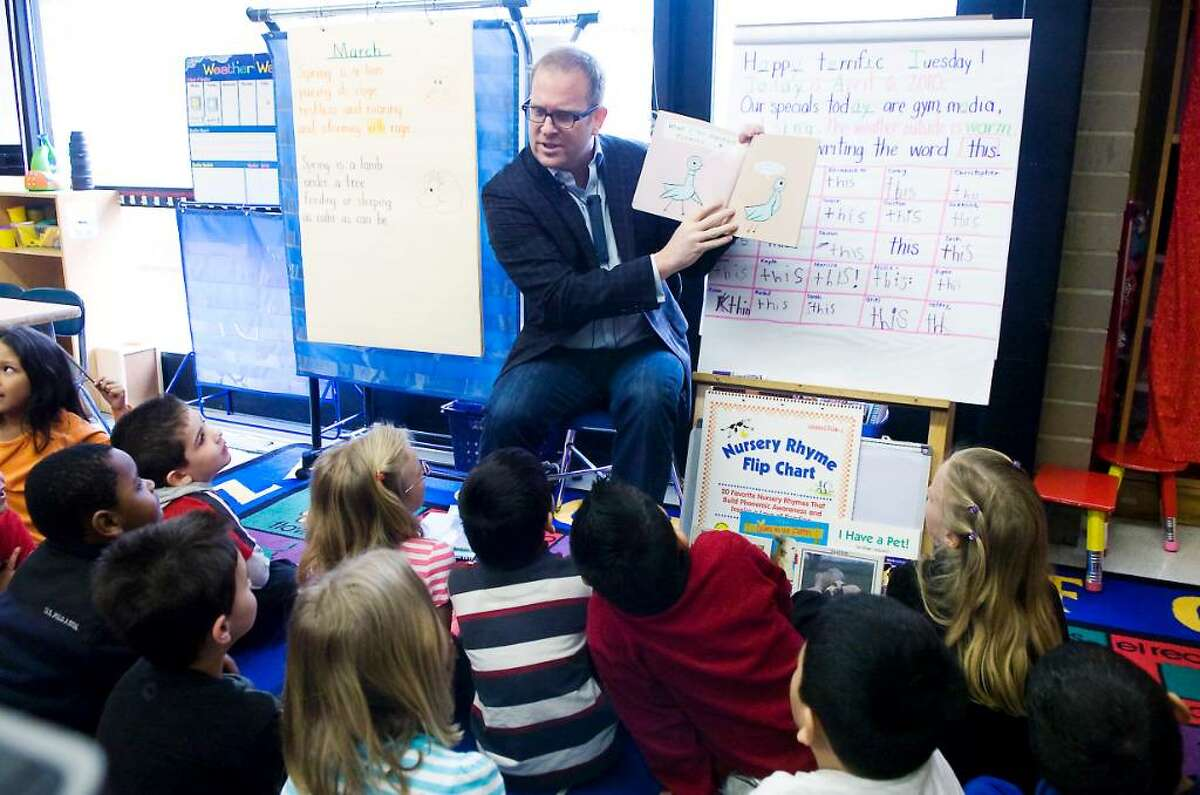 Paul Faulhaber, executive producer with NBC Universal, reads to kindergarten students at Toquam Magnet School as Stamford corporations participate in City-Wide Read-a-Thon in Stamford, Conn. on Tuesday April 6, 2010