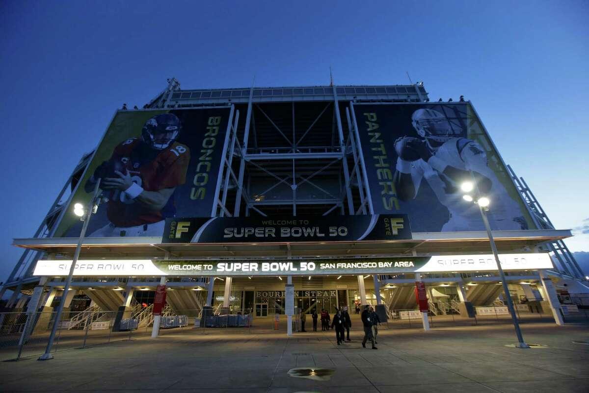 The entrance to Levi's Stadium is decorated with images of Denver Broncos quarterback Peyton Manning, left, and Carolina Panthers quarterback Cam Newton Tuesday, Feb 2, 2016 in Santa Clara, Calif. The Denver Broncos will play the Carolina Panthers in the NFL Super Bowl 50 football game Sunday, Feb. 7, 2015, at Levi's Stadium. (AP Photo/Marcio Jose Sanchez)