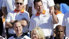 Denver coach Gary Kubiak (right), a star high school QB in Houston before eventually backing up his current boss John Elway (left) with the Broncos, forged strong friendships in his early years.
