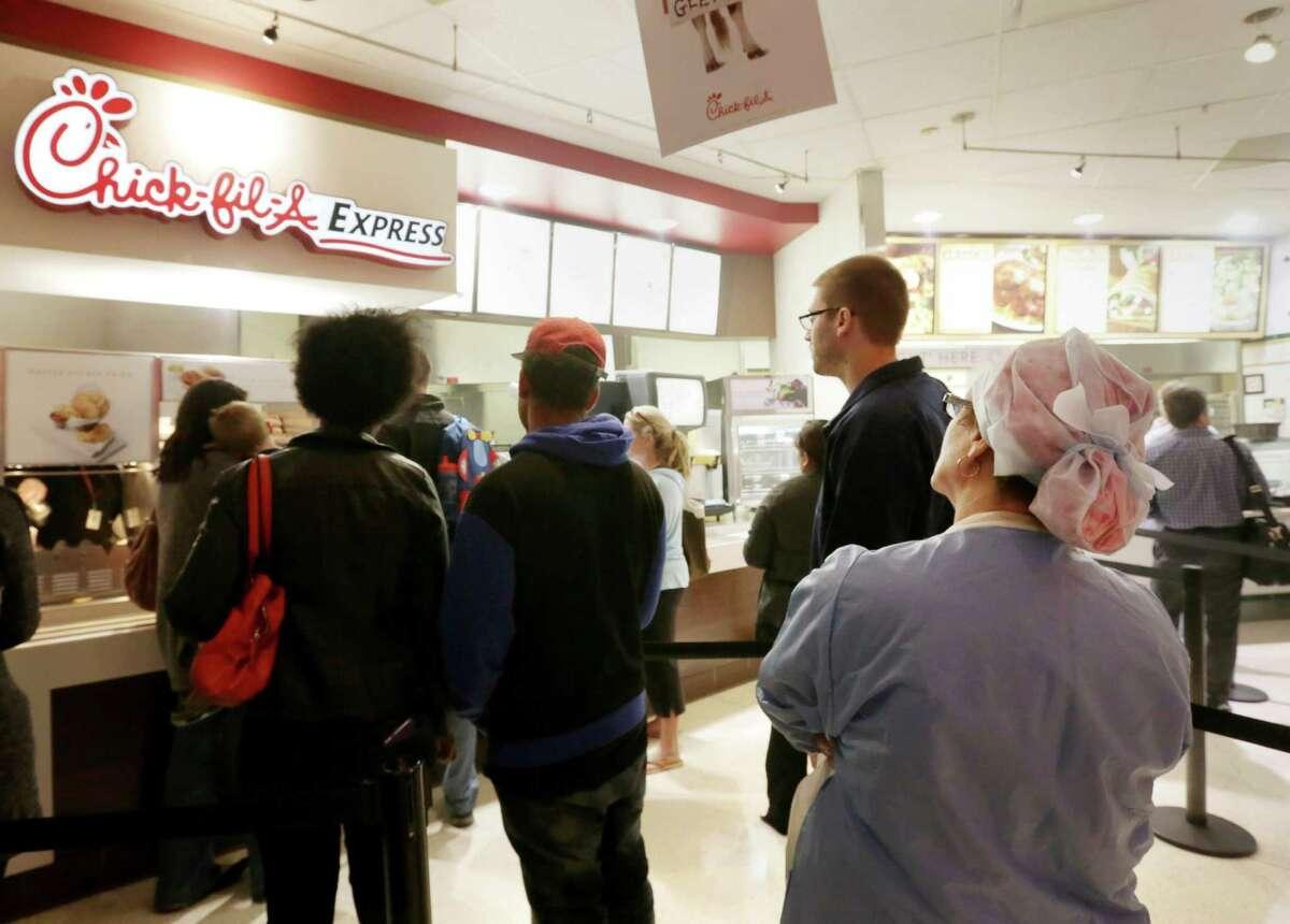 Kimberly Bibbins, an RN  at St. Luke's Hospital, waits through a longer line for a healthier choice.