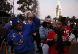 Bay Area natives Robin Butts, left and Patricia Morris break it down as they wait for Alicia Keys to take the stage at Super Bowl City Feb. 6, 2016 in San Francisco, Calif.